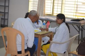 Medical professionals supporting Medical camp
